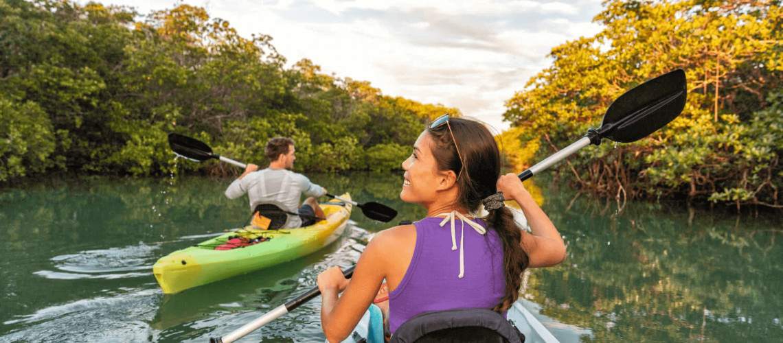 Picture of couple mangrove kayaking.